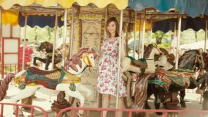girl-on-carousel-1393694_1280